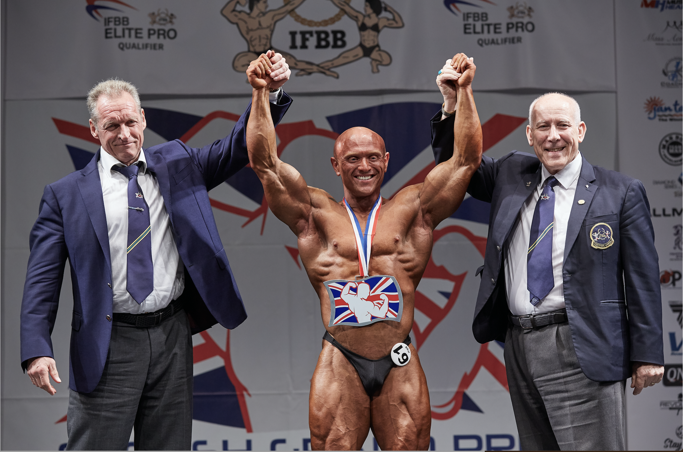 James Watts is congratulated by UKBFF president Bill Tierney (right) and event co-promoter Sean O'Reilly.