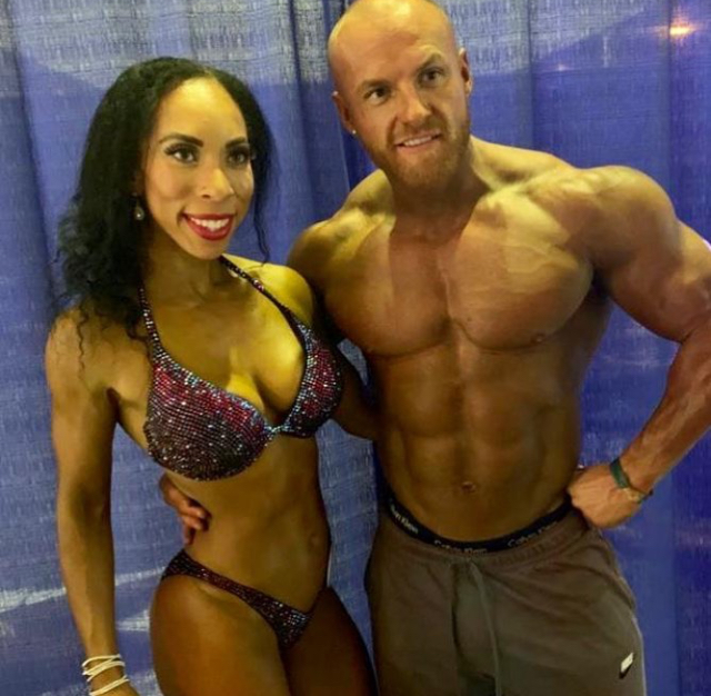 Stefanie Griffin and Matt O'Reilly flying the UK flag on stage in Barbados.