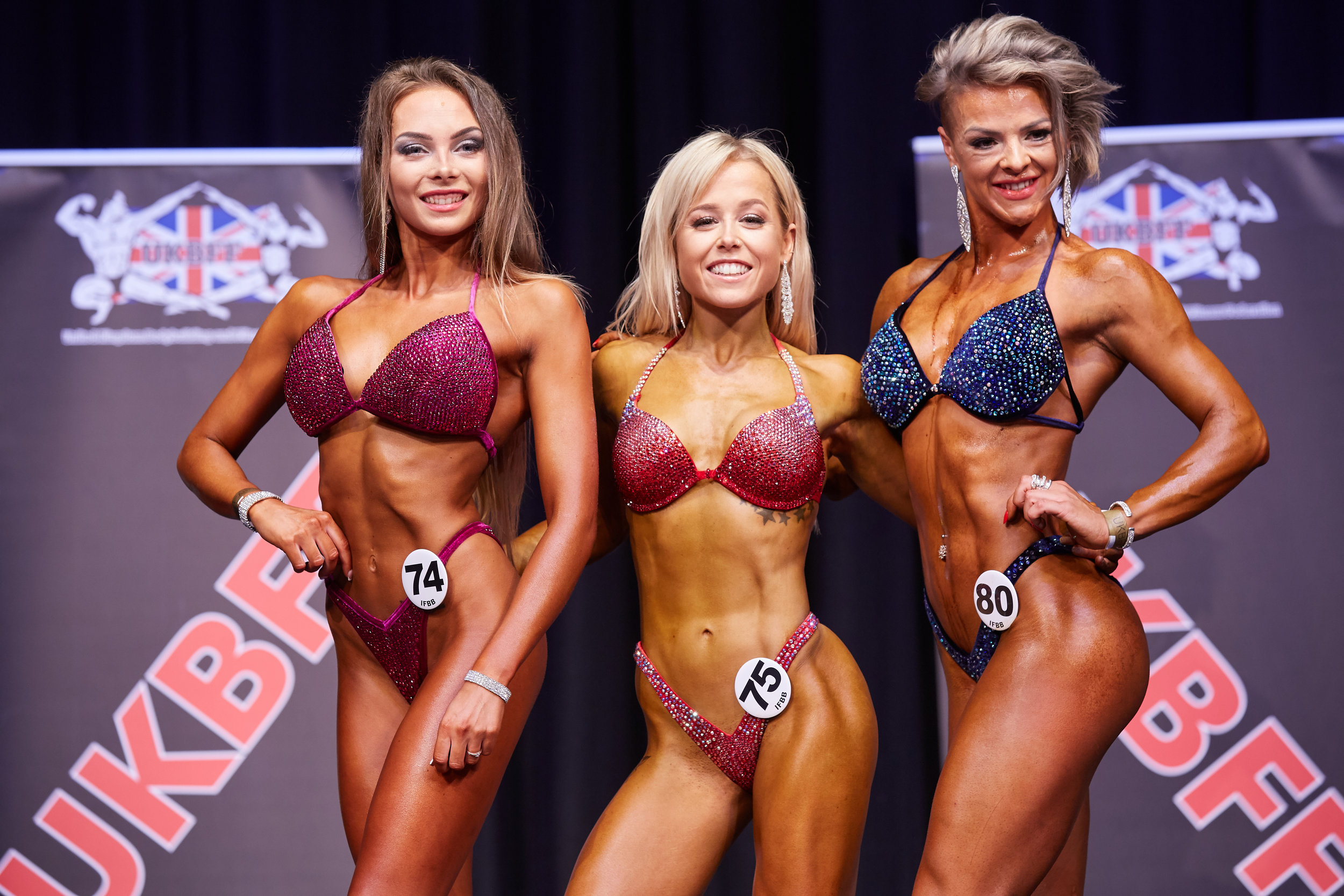 Hannah Wares (centre) wins bikini fitness up to 164 cm, ahead of runner-up Dehisa Ardeleah (right) and third place Gerda Siaciulyte.