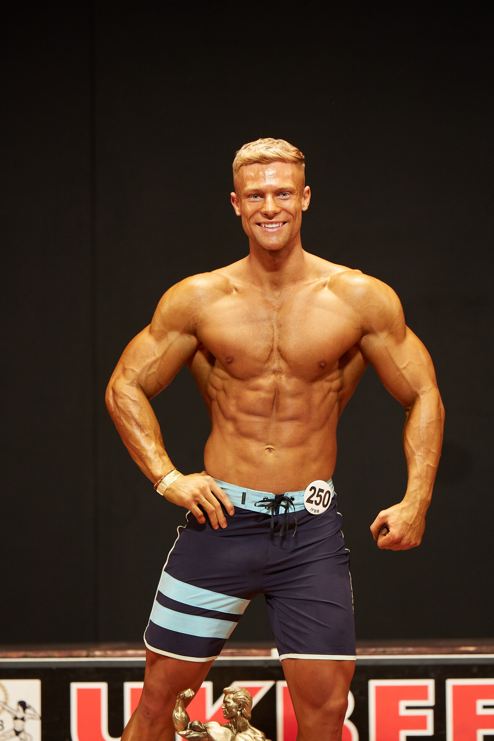Muscular men's physique champion Harley Judge.