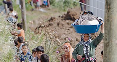 refugees in the darK: fleeing a devastated syrian town - Time Magazine, June 14, 2011