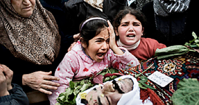 as the slaughter goes on, the Syrian opposition still can't agree about an armed response - Time Magazine, March 1, 2012