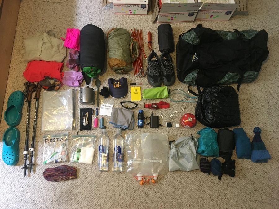 Look at all this stuff I bought so I could go live in the woods for four months. I ended up dropping the crocs, pack towel, notebook, iPod, two tent stakes, and my stove bag.