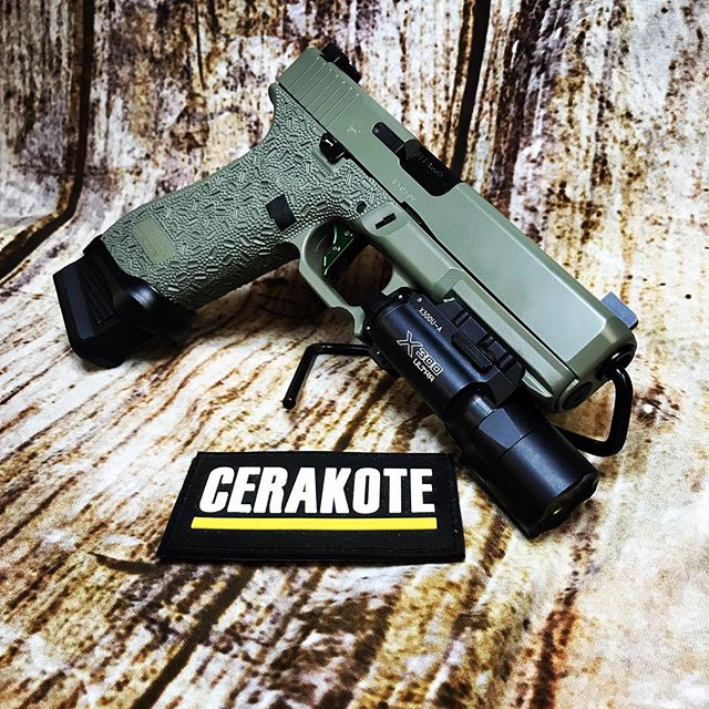 "This gen 5 Glock 17 has been Cerakoted in ELITE series ""jungle"". We also added a few extra aftermarket parts! #cerakote #cerakotelove #cerakotemafia #cerakoteaddict #cerakoteeliteseries #cerakoteelite #cerakoteelitejungle #sublimemodifications #sublimemodificationsrocks #valdosta #valdostascertifiedcerakoteapplicator #surefire #surefirex300 #overwatchprecisiontrigger #overwatchprecision #ameriglosights #ameriglo #zev #zevtech #zevtechnologies #stippling #hahira #hahiralife #tiftonga #tiftonga #adelga #9mm #9mmpistol"
