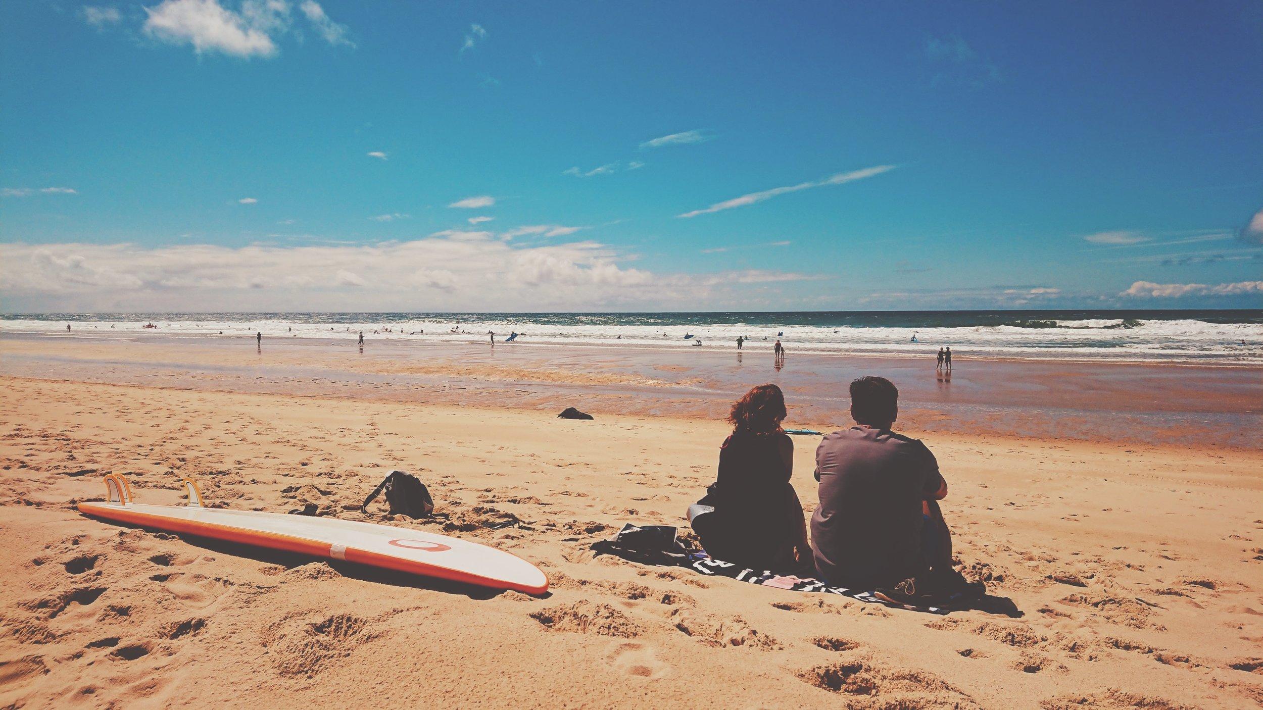 beach waves family watching-min.jpg