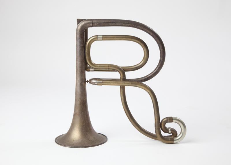 Szymanski_Carol_Alphabet_Horns_r_2000-2012_brass_15x7_inches_irregular.jpg