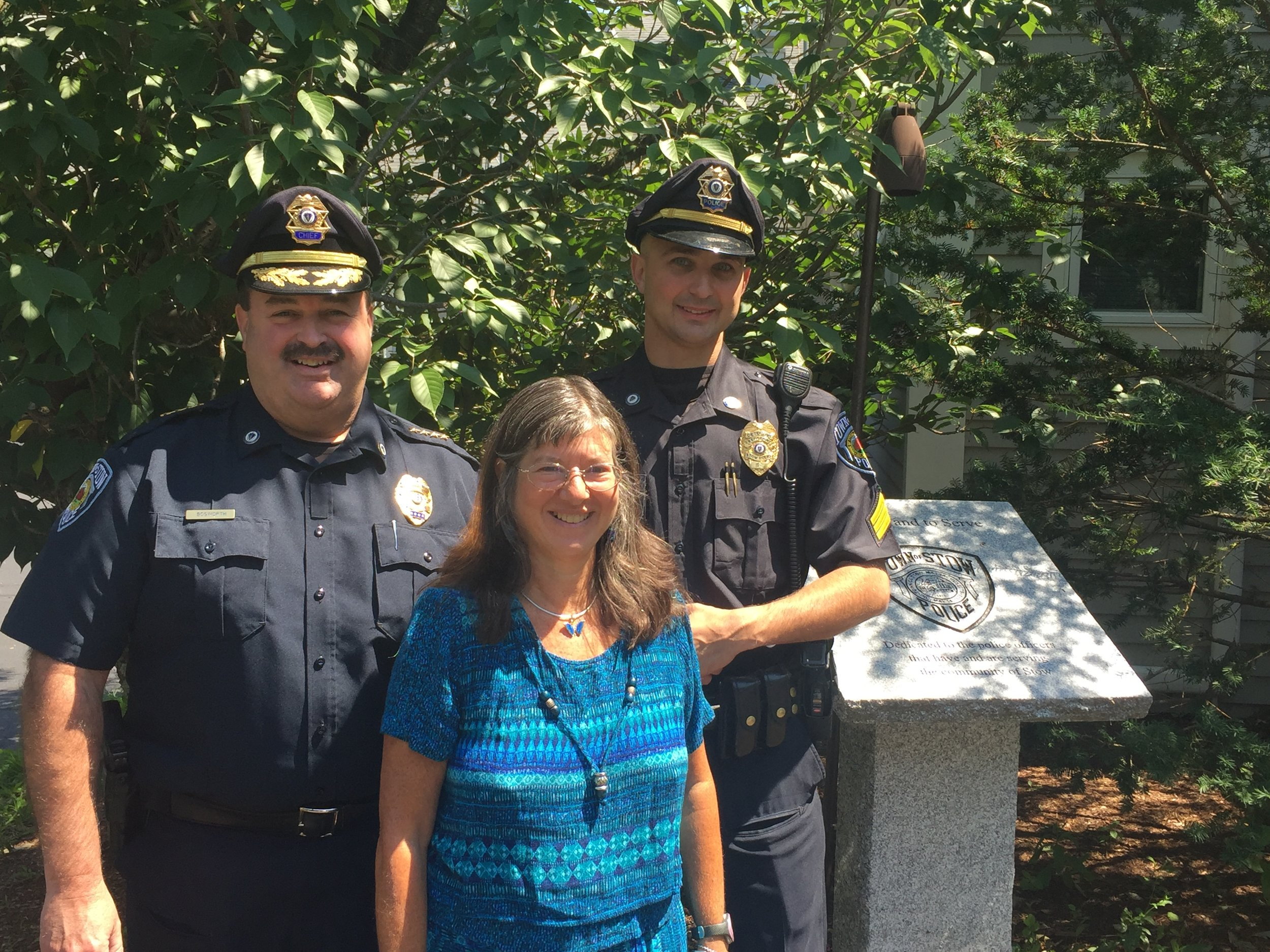Stow Police and a citizen work with Communities for Restorative Justice