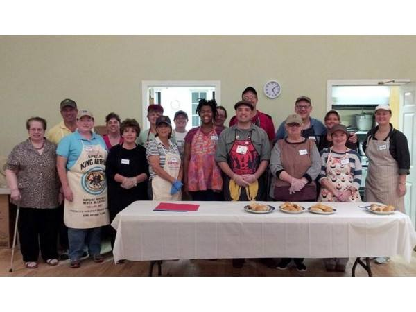 Volunteers are prepared to serve a meal at the First Parish Church of Stow and Acton monthly Guest Table dinner
