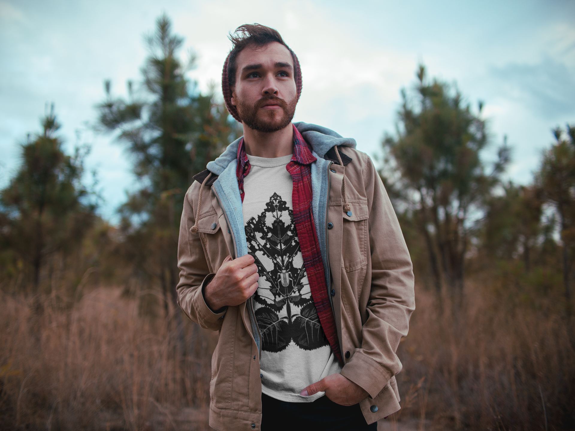 dude-with-beard-wearing-a-tshirt-mockup-watching-the-landscape-outdoors-a19030.png