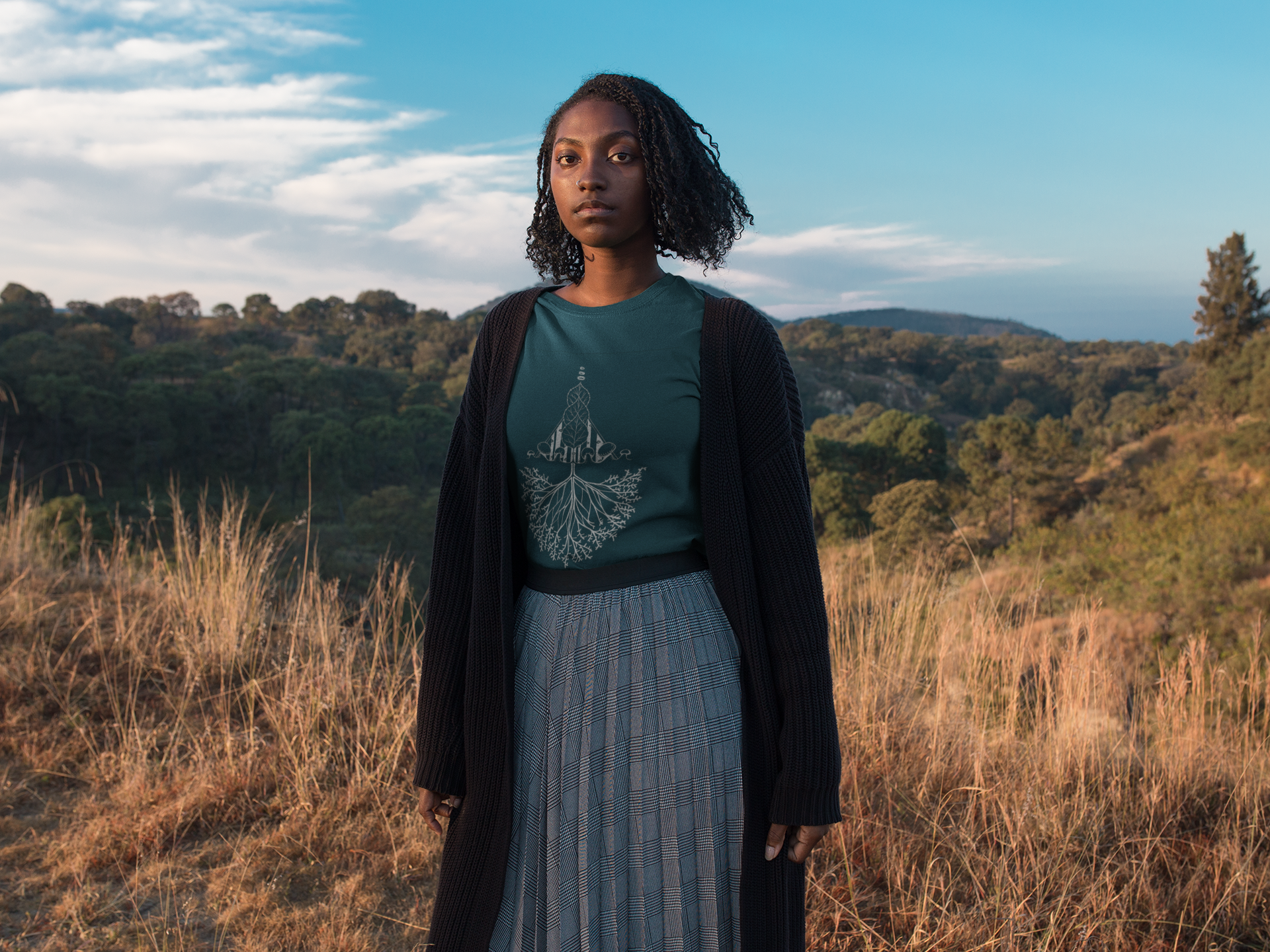 mockup-of-a-black-woman-wearing-a-tshirt-while-outdoors-on-the-mountains-a18514.png