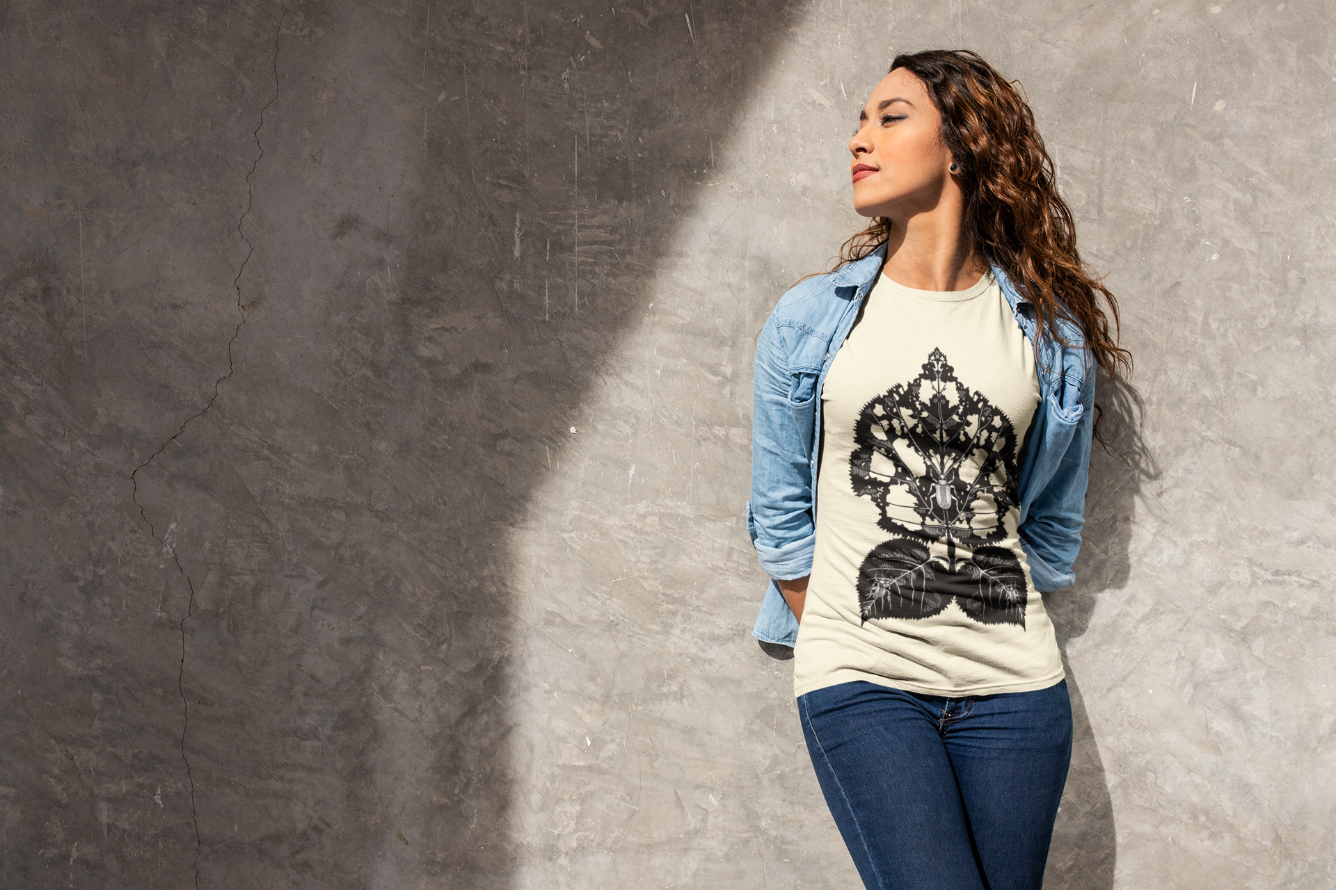 tee-mockup-of-a-woman-casually-leaning-on-a-wall-24663.png