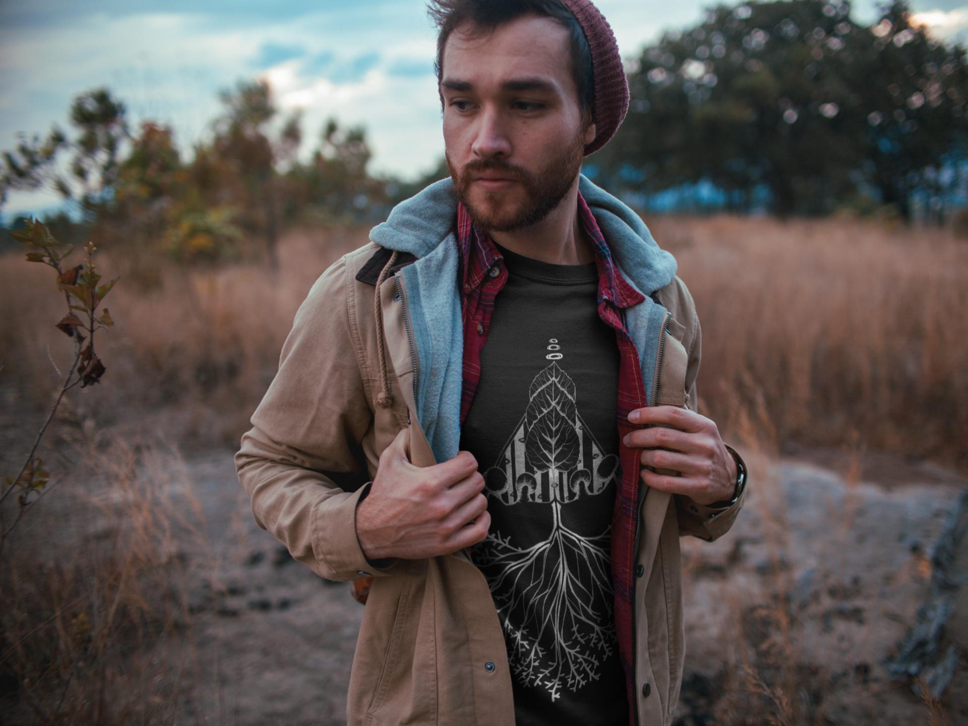sad-man-walking-outdoors-wearing-a-t-shirt-mockup-a19029 (1).png