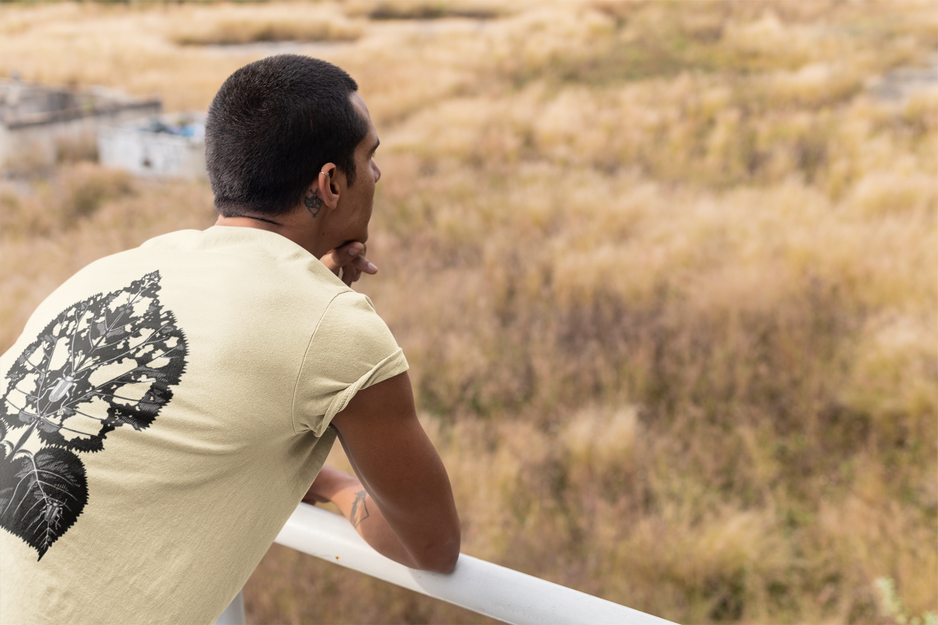 back-view-mockup-of-a-man-wearing-a-t-shirt-looking-to-the-horizon-outdoors-24529.png
