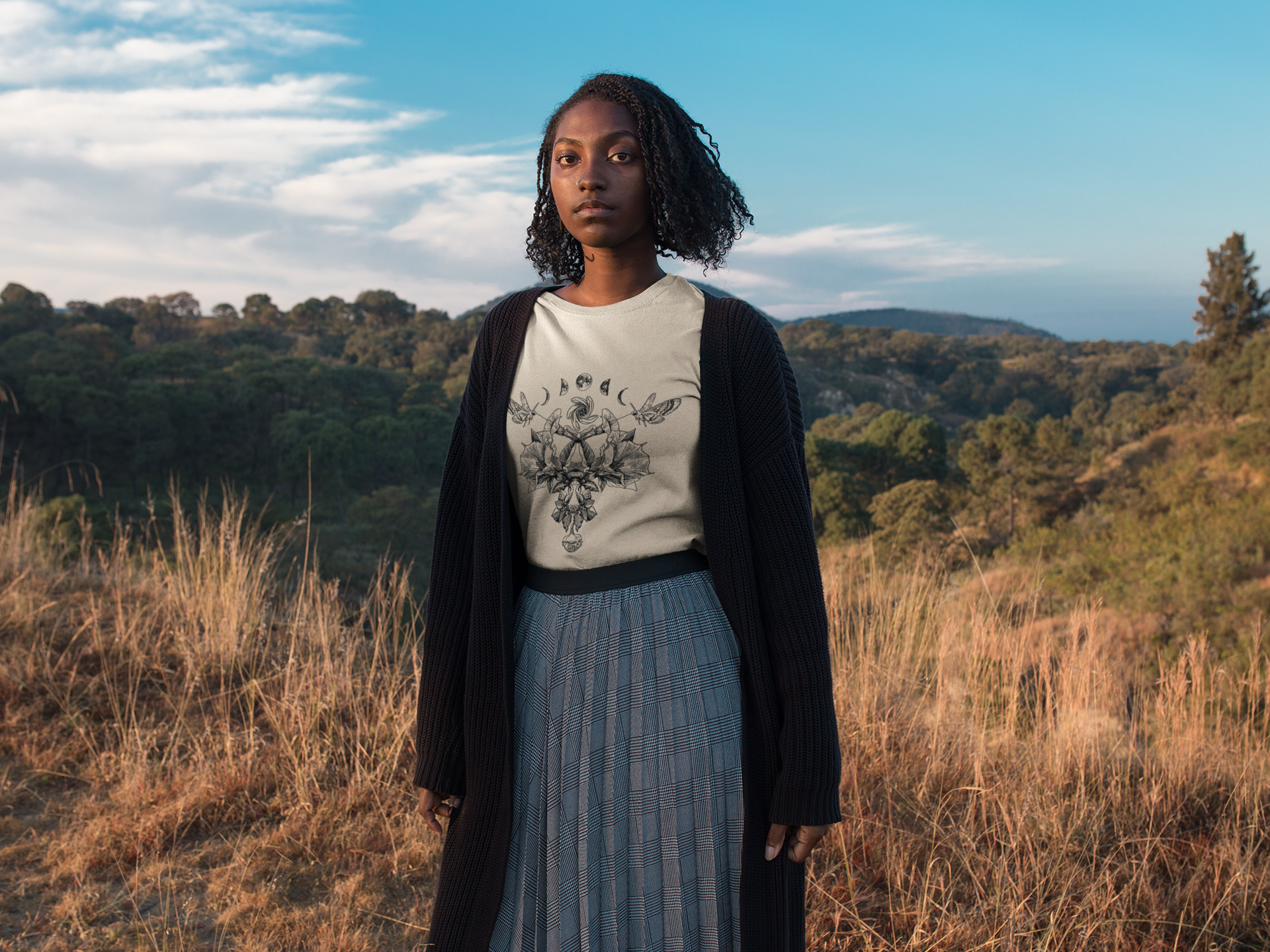 mockup-of-a-black-woman-wearing-a-tshirt-while-outdoors-on-the-mountains-a18514 copy.png