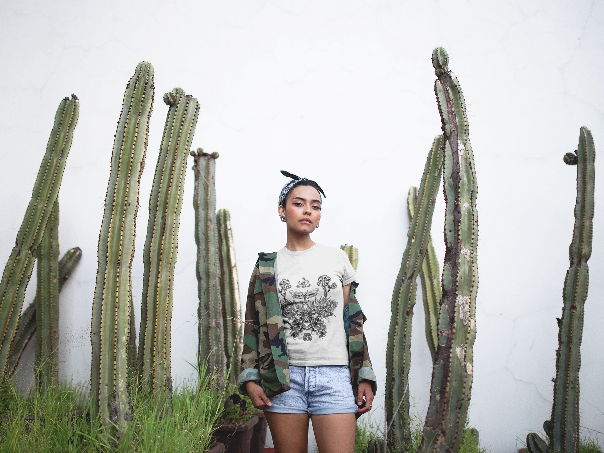 t-shirt-mockup-featuring-a-woman-standing-by-cactus-plants-17211.png