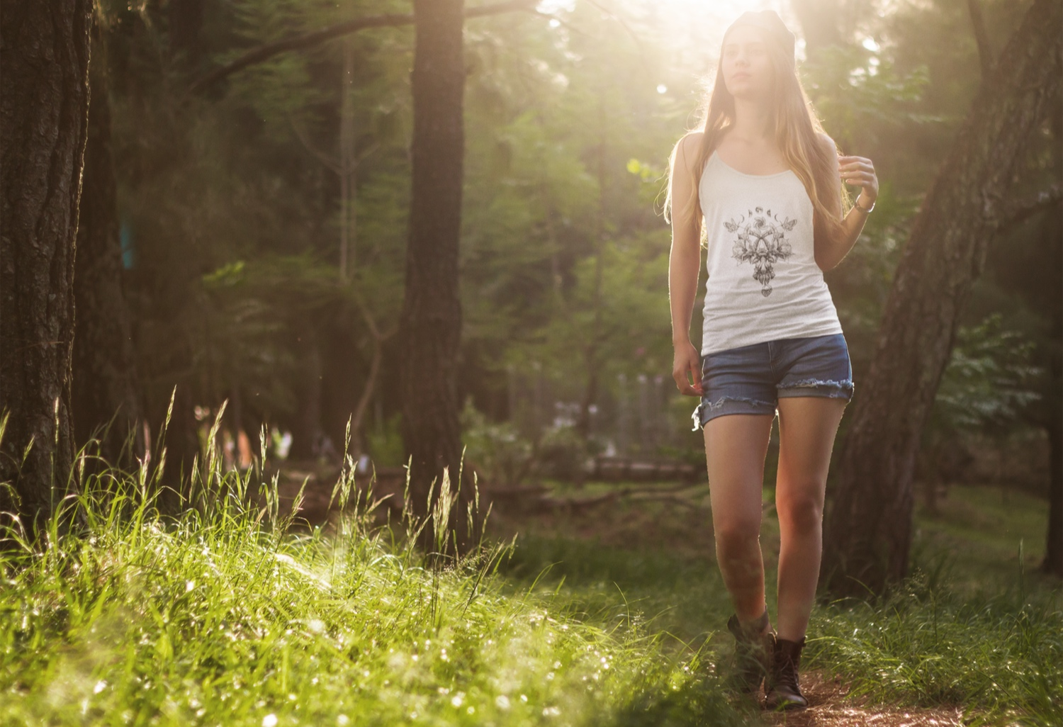 tank-top-mockup-template-of-a-girl-hiking-in-the-woods-6821a.jpg