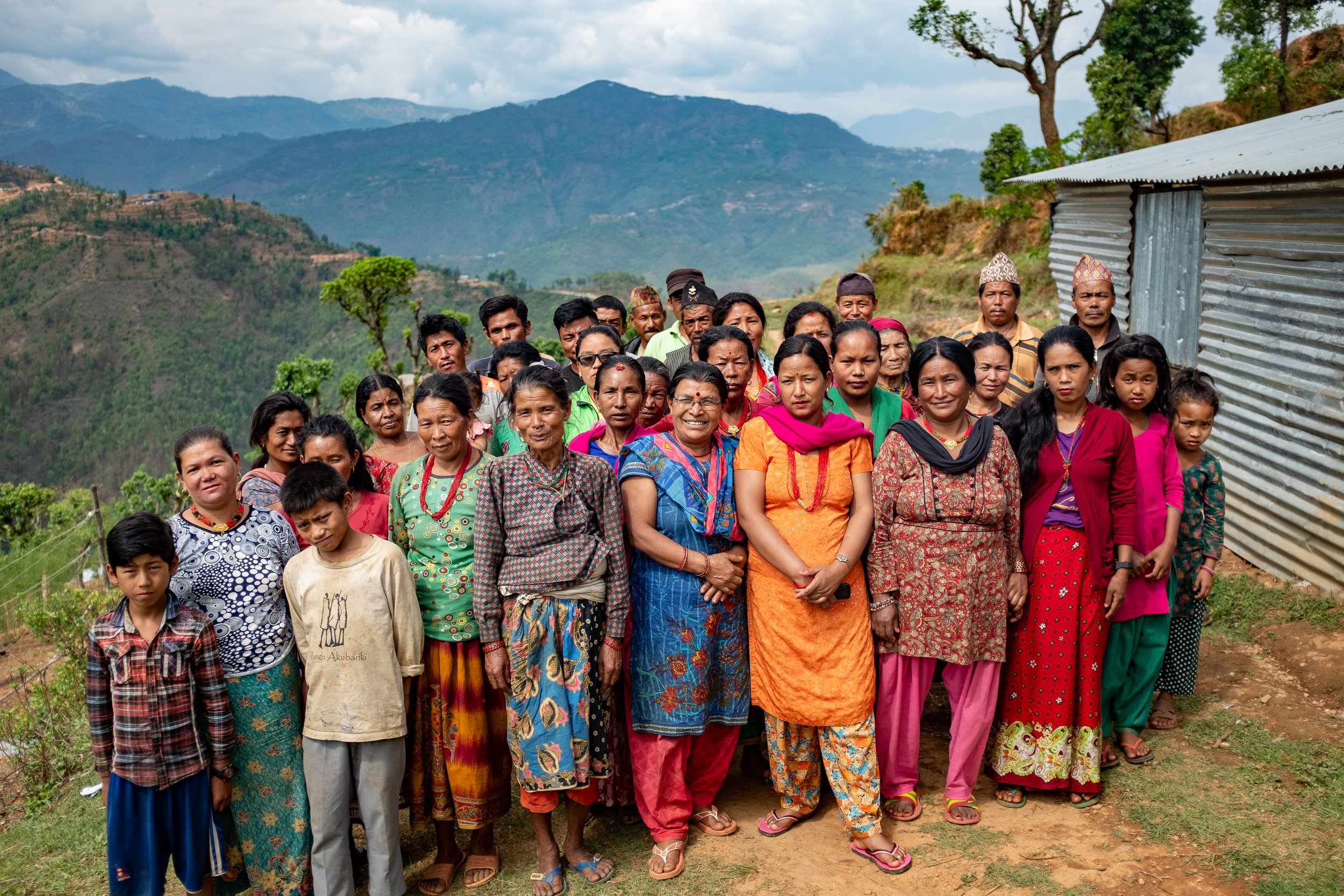 Self-help groups like this one in Upper Bhotsipa are helping men and women save money and make loans, addressing some of the areas that made recovery difficult after the earthquake.