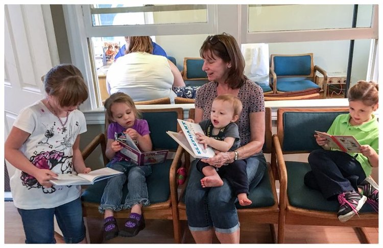 LLCMC Volunteer reading to kids.jpg