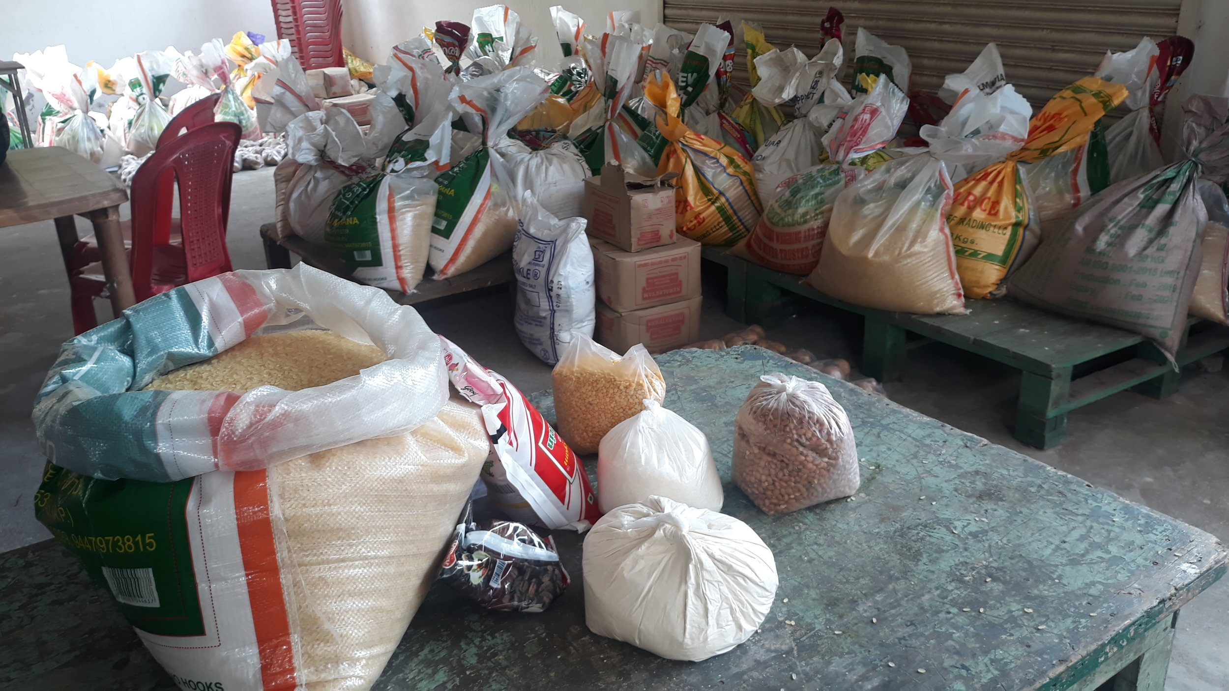 Food staples being prepared for distribution