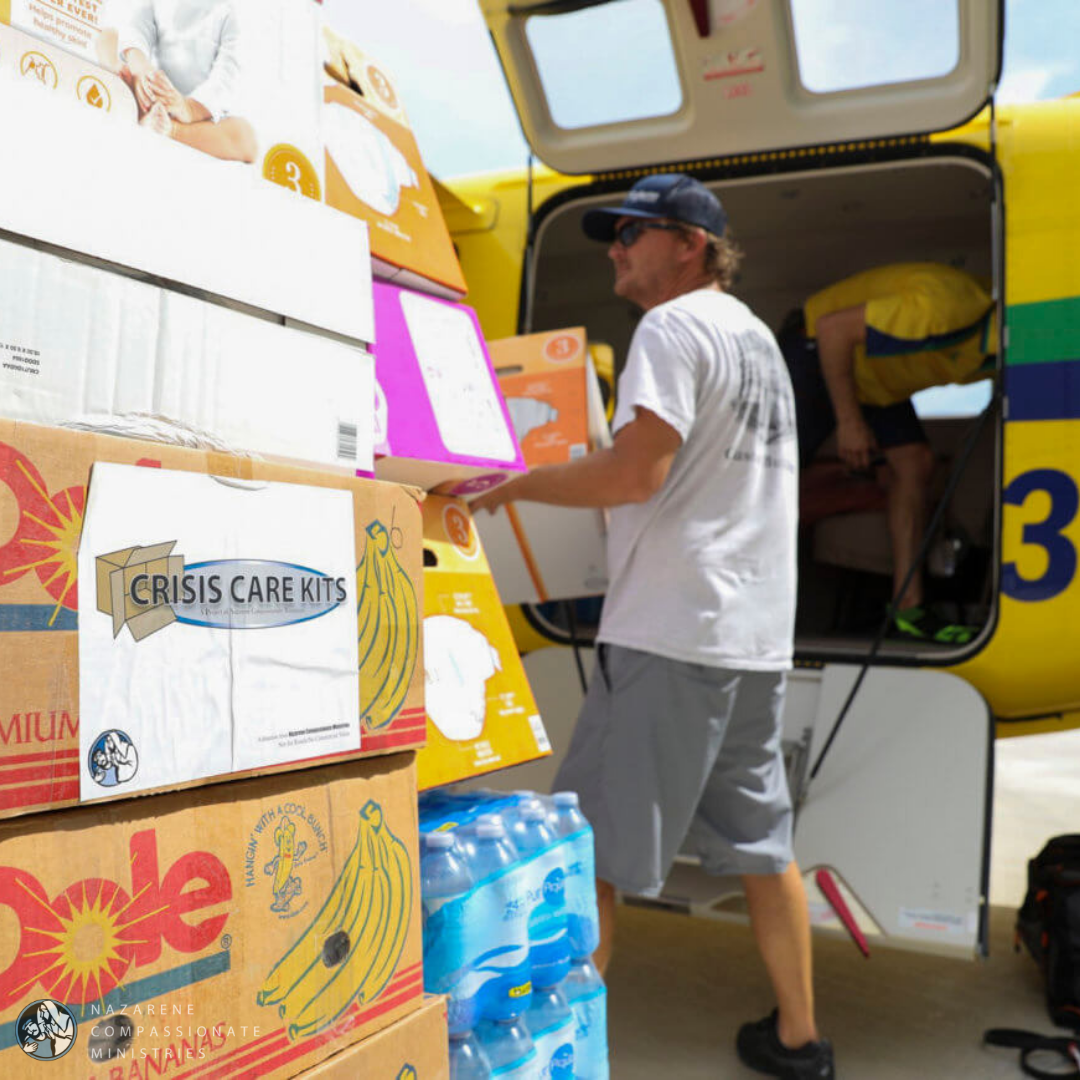Volunteers unload crisis care kits from a plane in Nassau, Bahamas. (Photo/Jess Heugel)