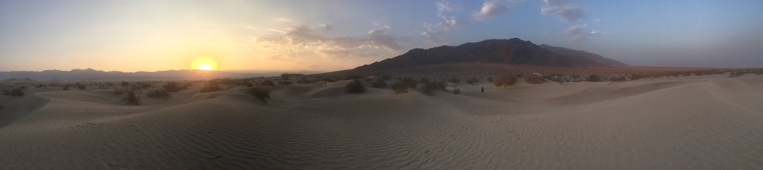 I took the above picture at sunrise last year in Death Valley National Park. You can barely make out my wife in the photo -- a tiny black speck about 1/3 of the width in from the right margin.