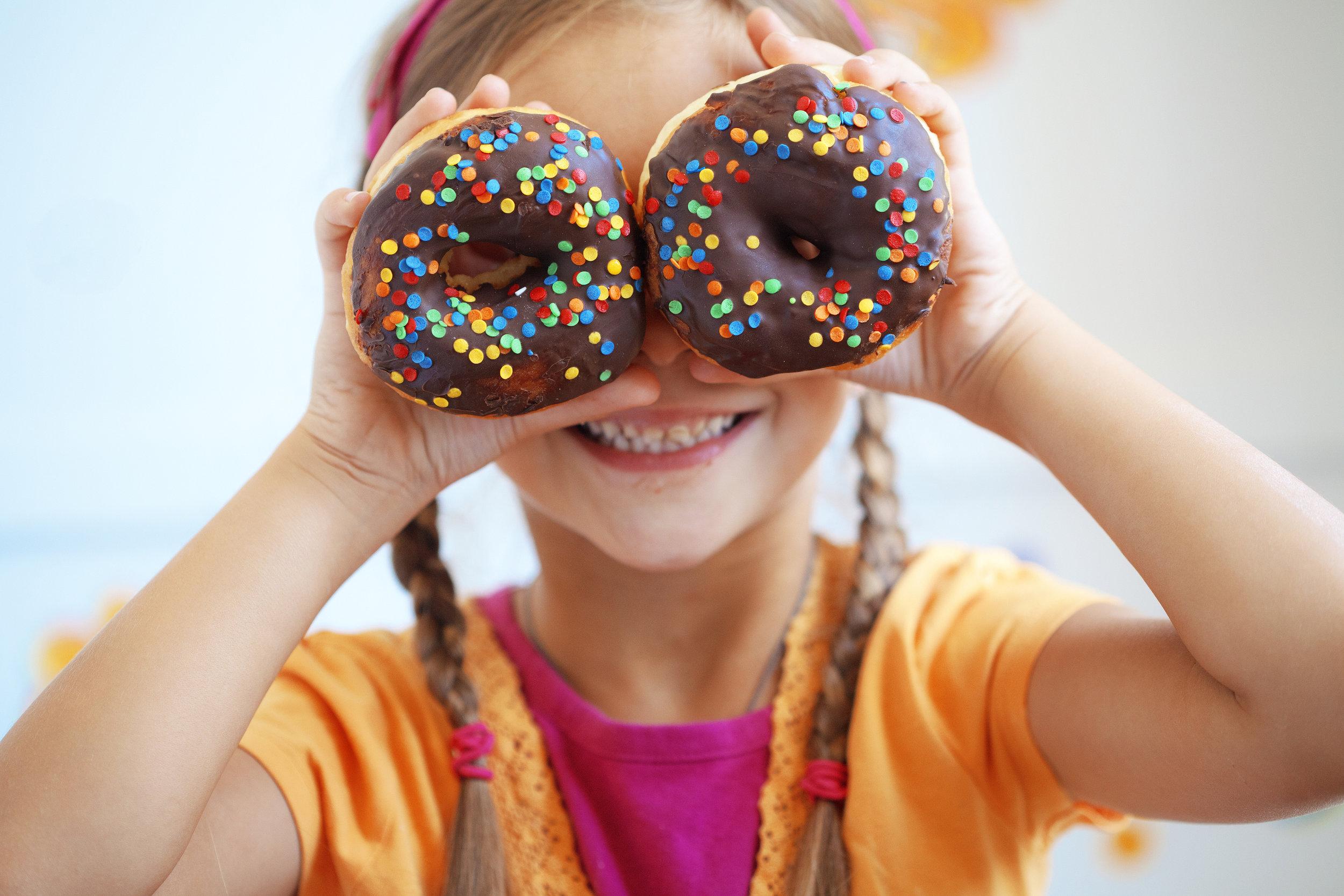 bigstock-Cute-kid-girl-eating-sweet-don-36555823.jpg