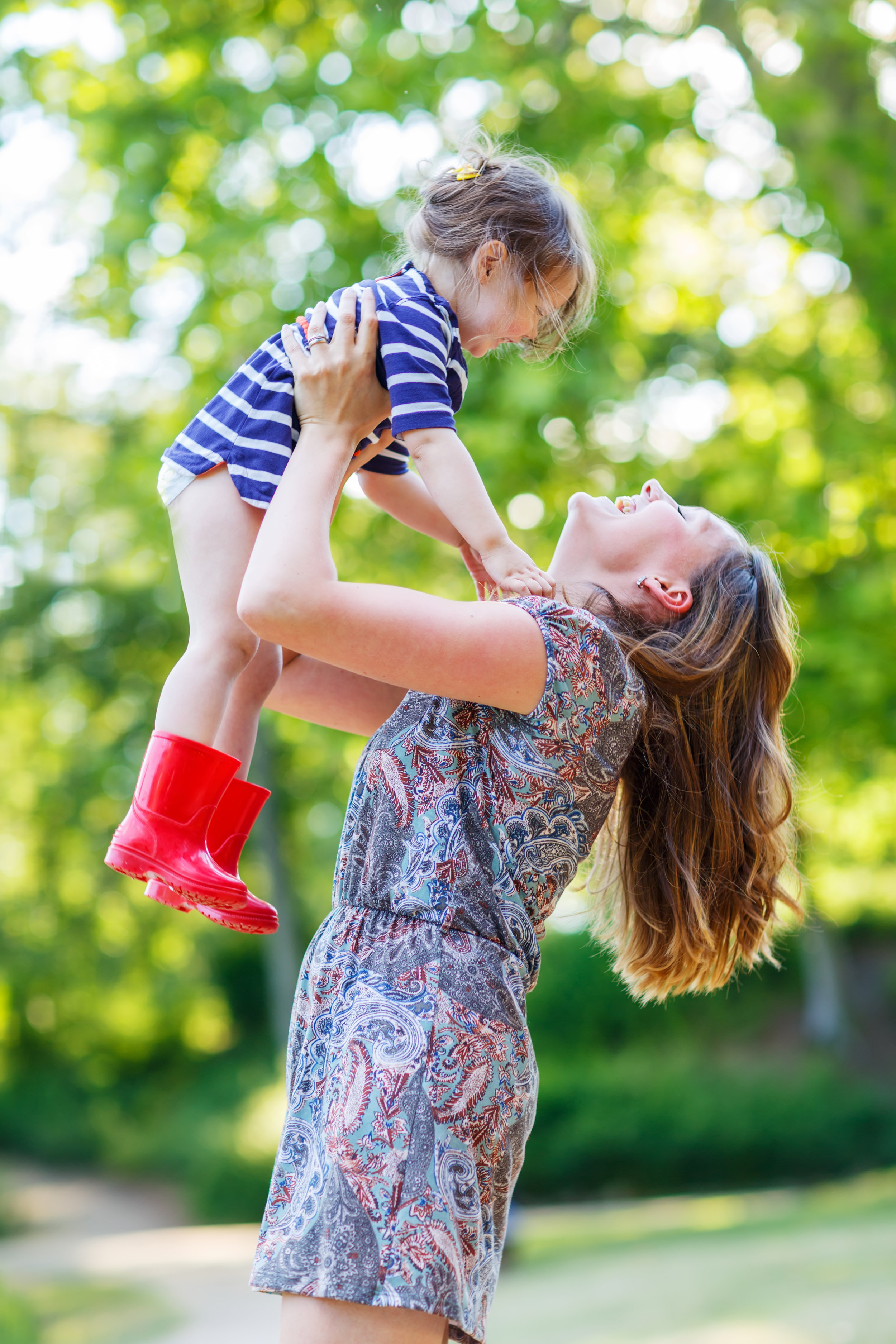 bigstock-Beautiful-Young-Mother-Holding-76133777.jpg