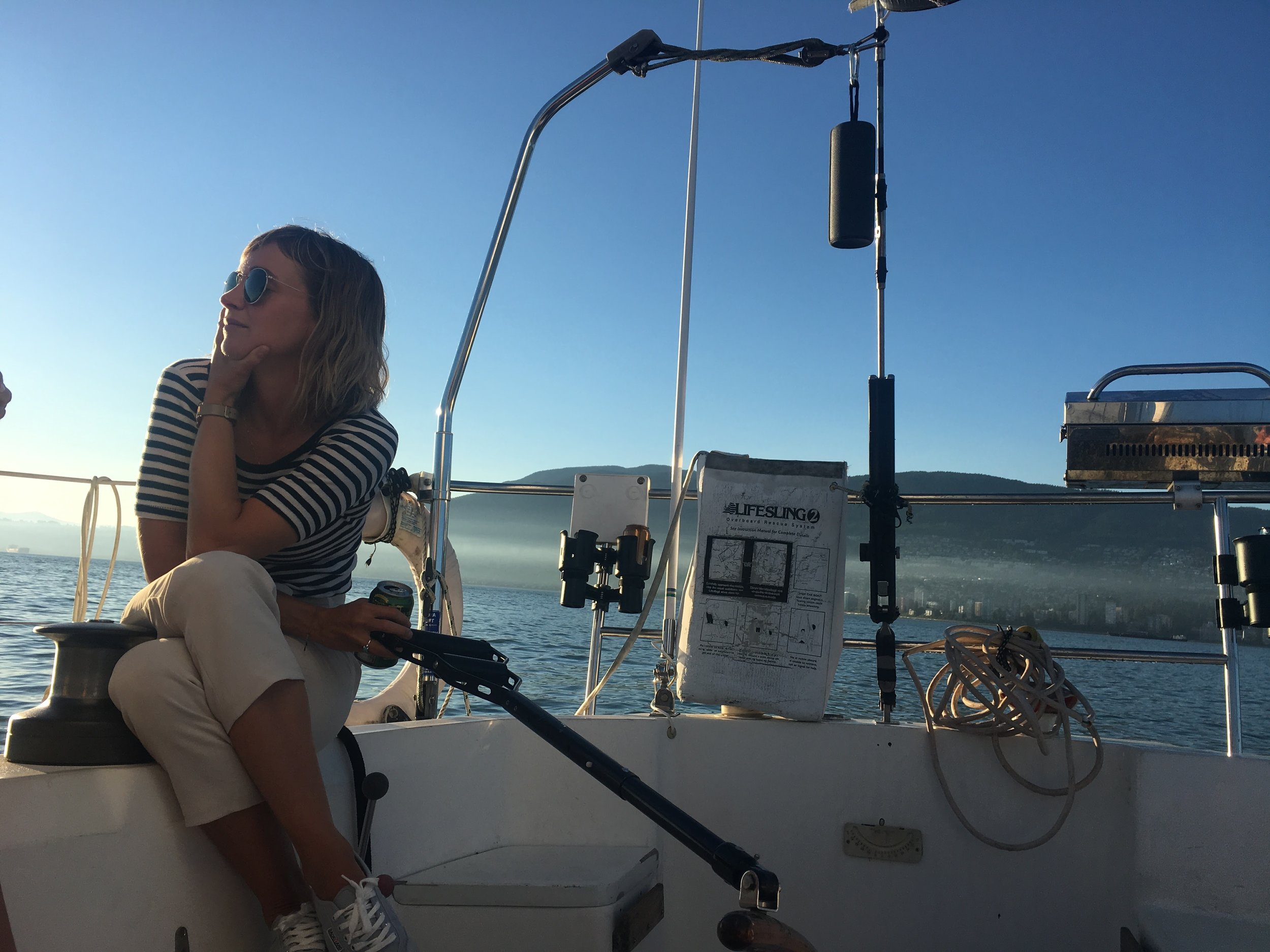 At the helm of a friends boat in English Bay last summer