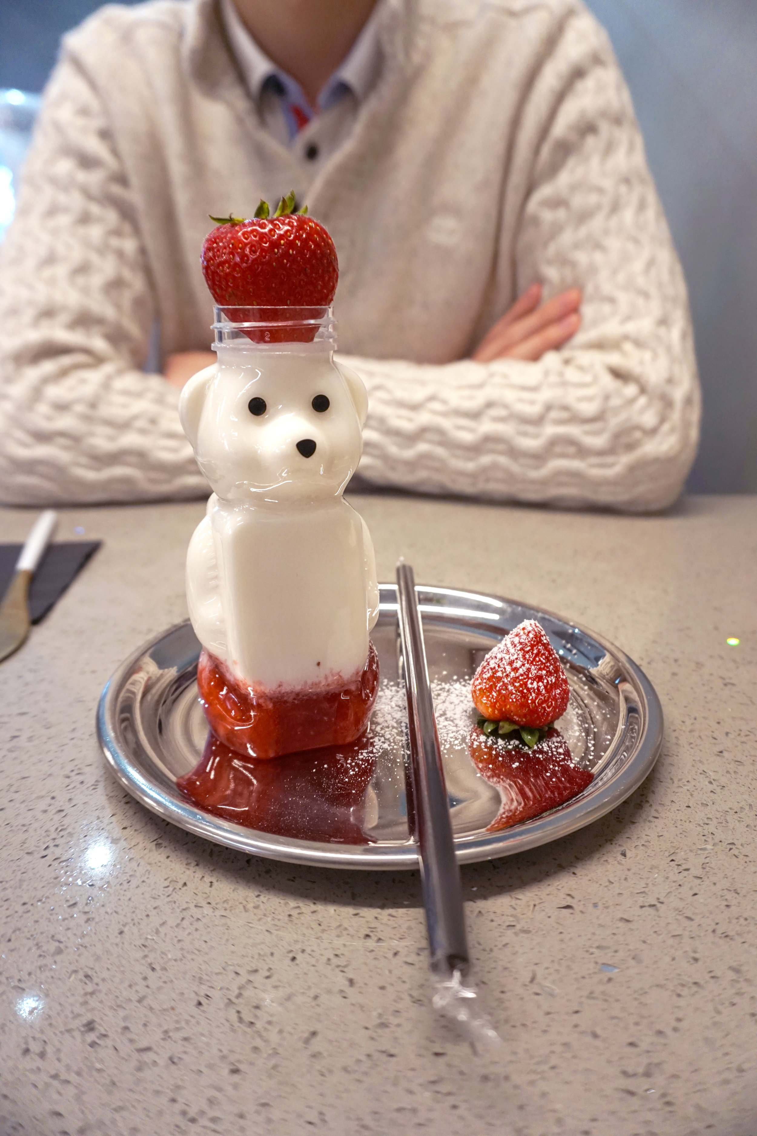 """""""Strawberry Milk"""" made from, you guessed it, fresh crushed strawberries and whole milk, displayed in the cutest bear jar (that looks like those squeezable jars of honey). Yum."""