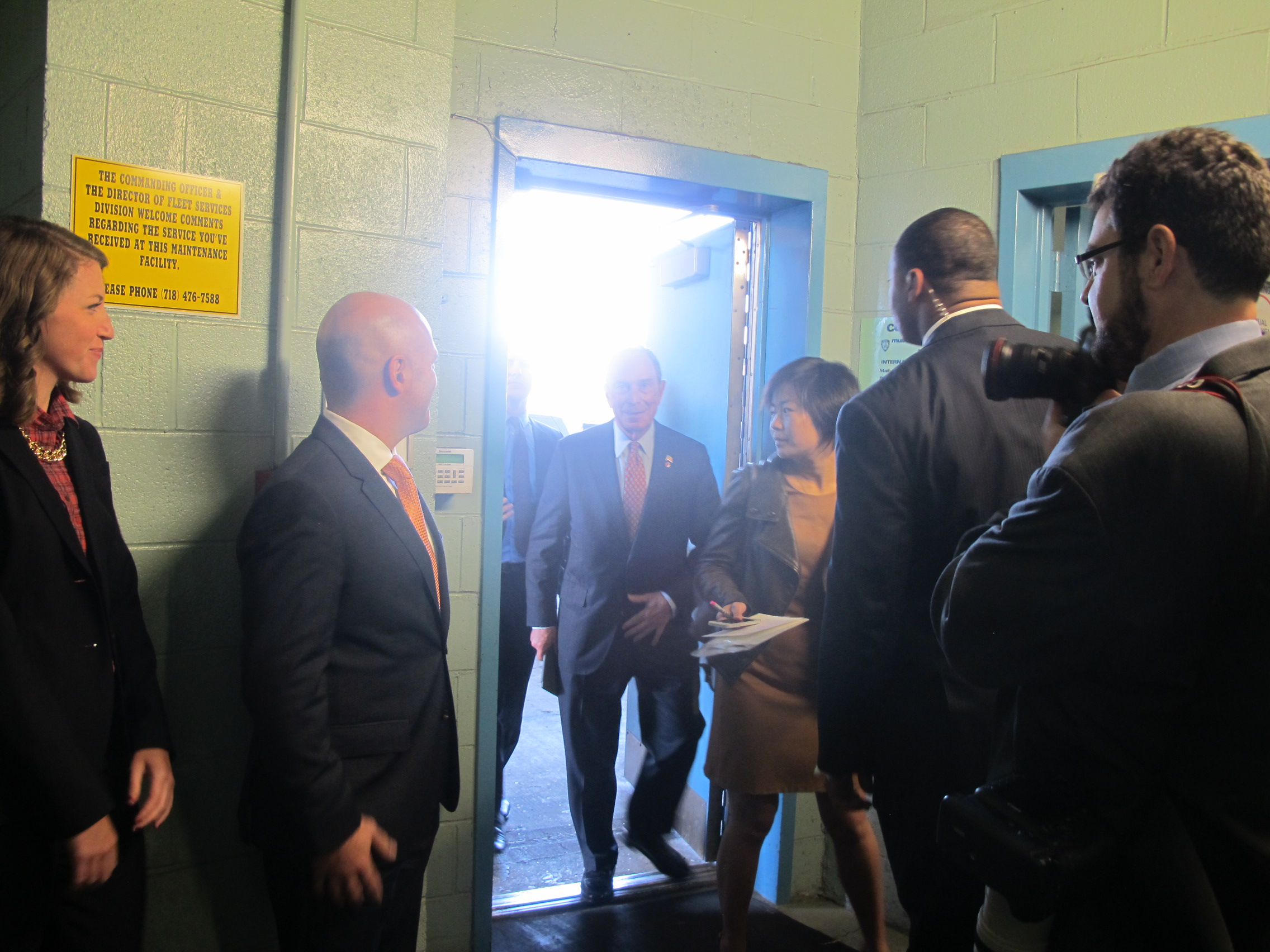 At a high profile event in New York City, where my project launch was marked by a press release by Mayor Bloomberg.  I'm standing to the left waiting to meet him in a police holding cell.