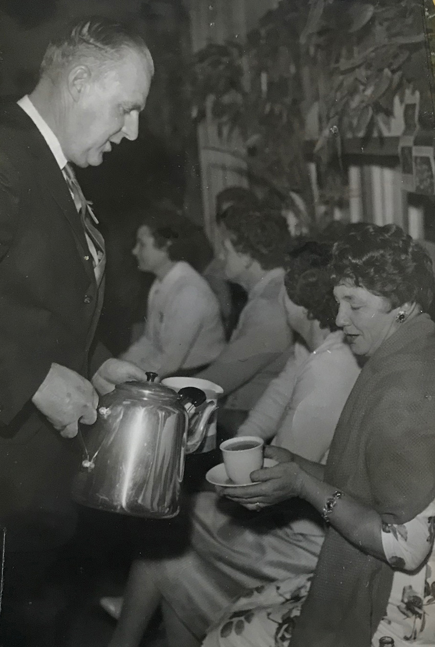 Mr ravenscroft serving tea to a member of the school mothers group