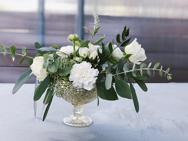 Simple and elegant!  I find white on white bouquets and centerpieces challenging in a good way!  Because it makes your imagination work harder!