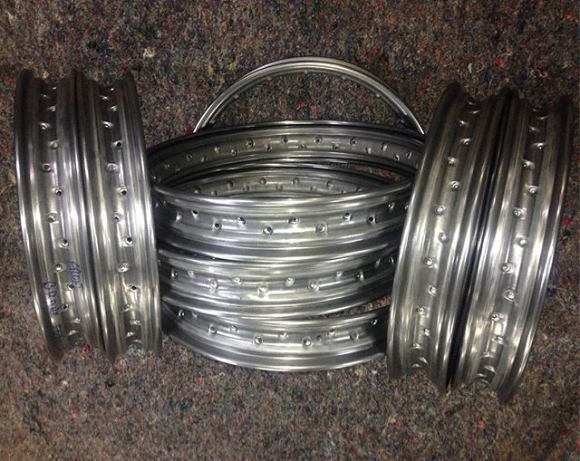 "These are 18"" rims for KJ  Henderson motorcycles . They are unique with the edge rolled out and under. Was that a challenge or what !!And a few more rollers to make. Henderson#indian #excelsior"