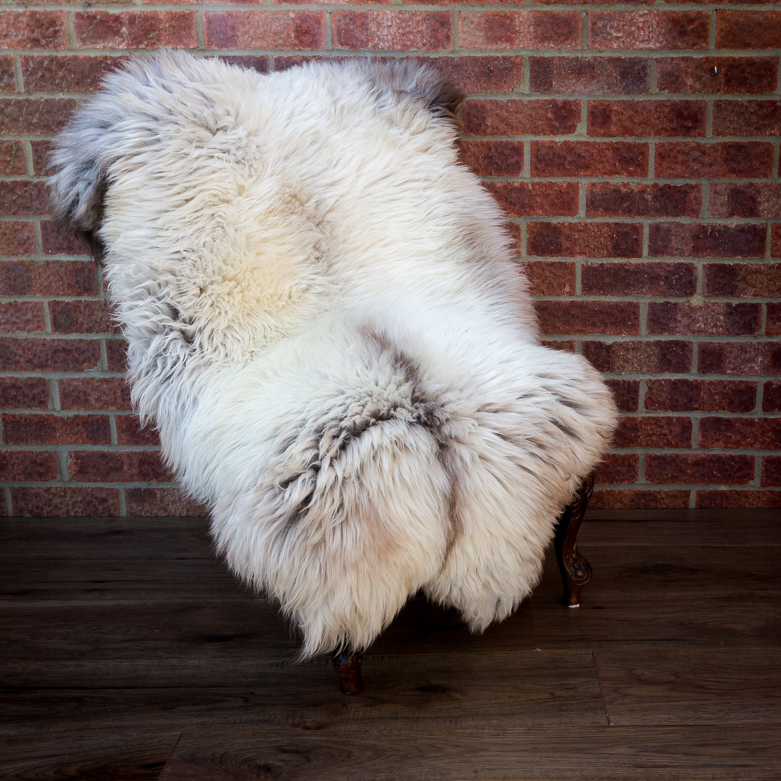 Very dense, light cream sheepskin rug