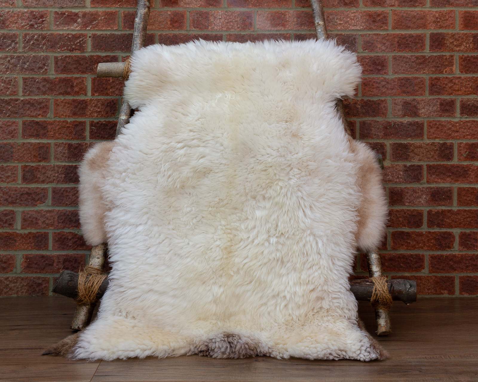 Cream with brown patches sheepskin rug