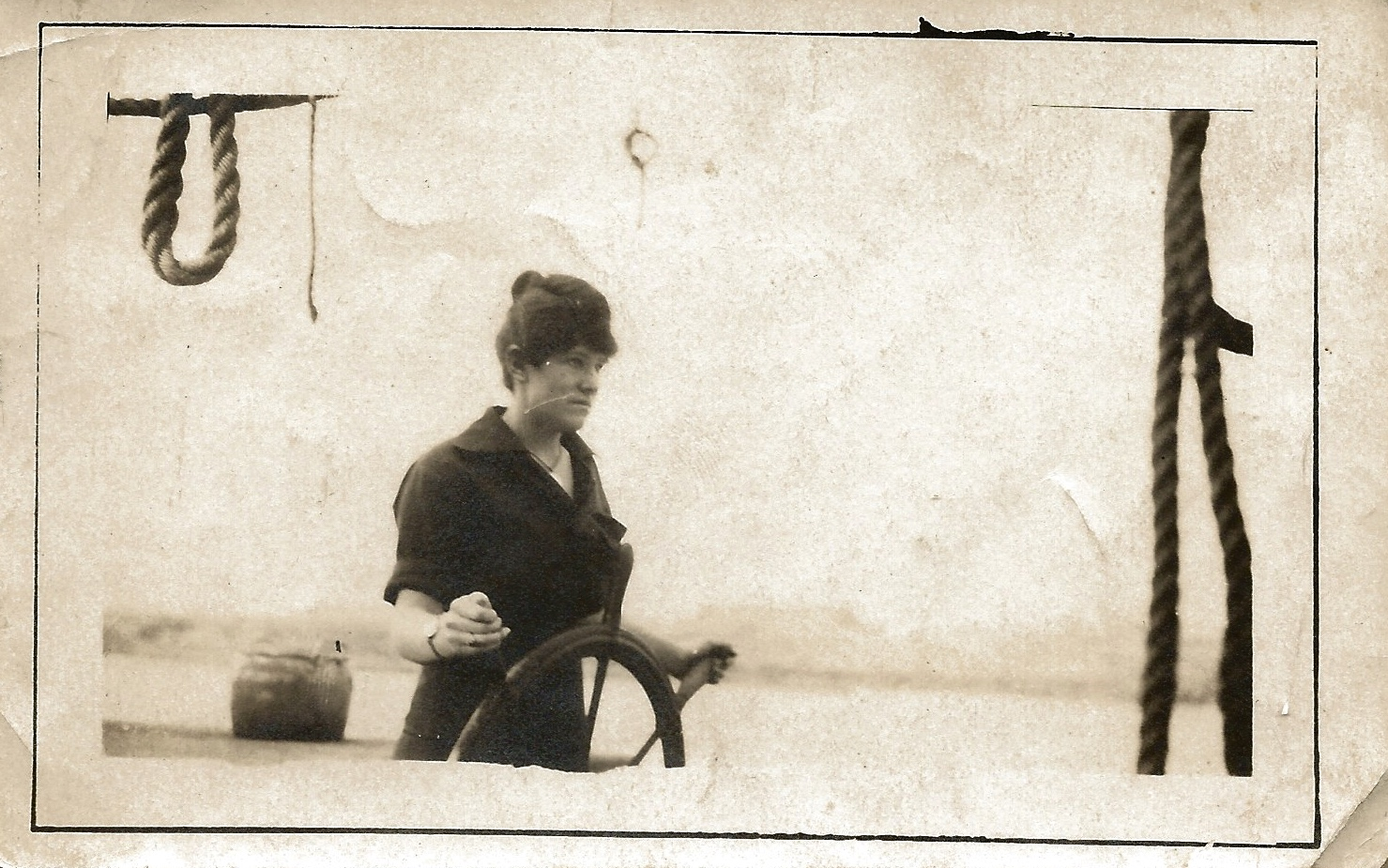 This is Bertha at the helm of some vessel. No doubt she threw the captain overboard.