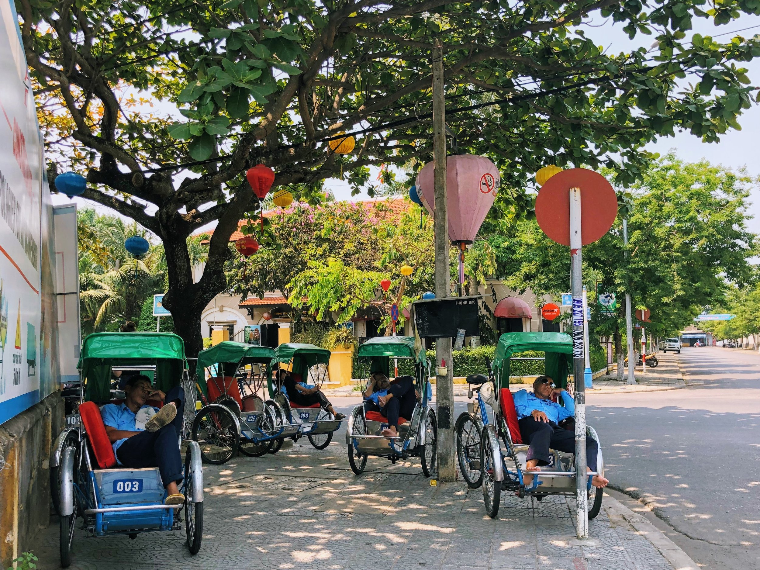 Cyclo drivers taking a siesta in the midday heat.