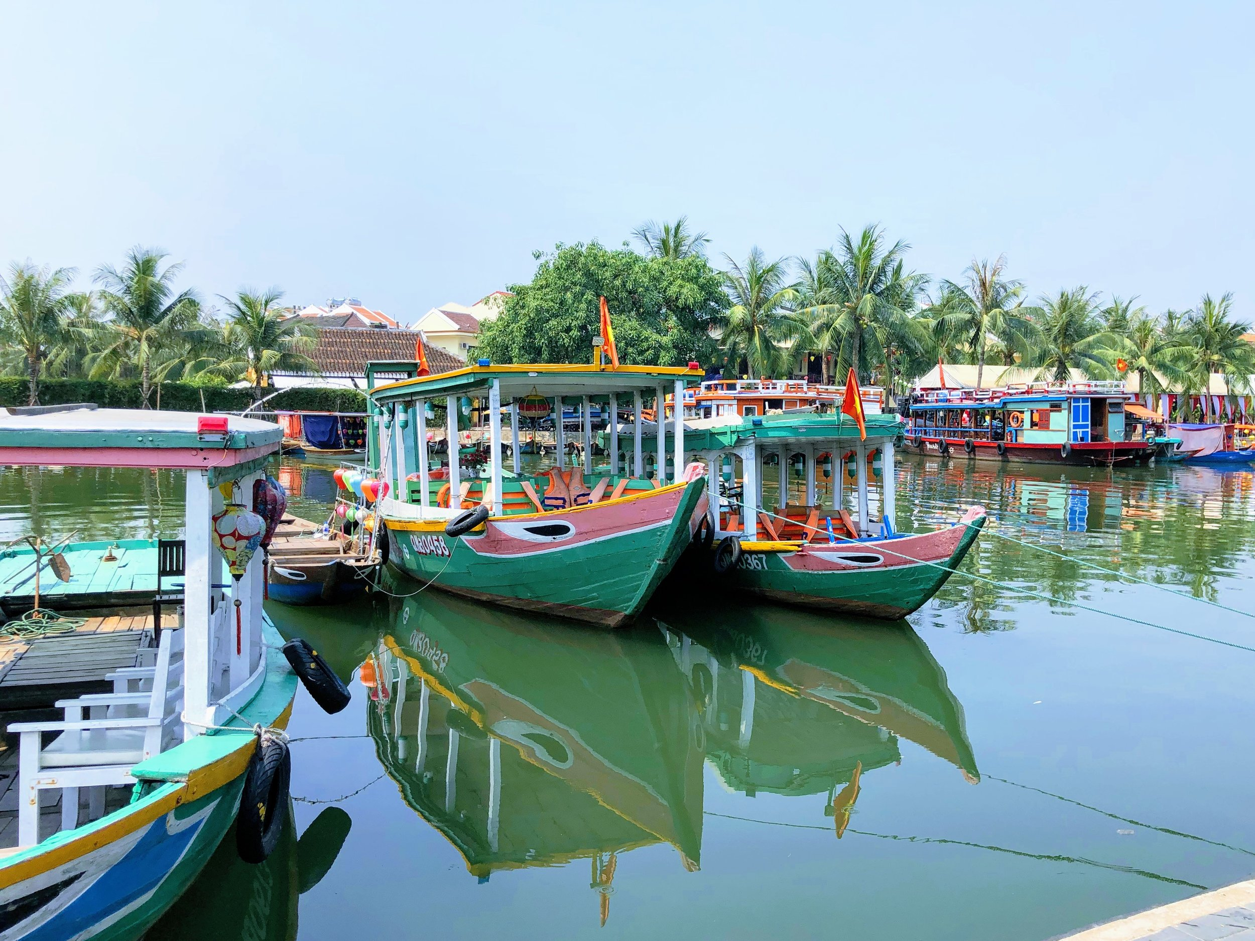 Boats docked along the river in Hoi An.