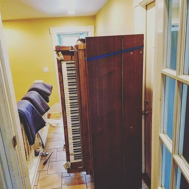Moving our player piano out of the basement! That's why they get paid the big bucks! Thanks guys from D.C. Moore and Sons. #pianomovers #piano #pianoplayer #playerpiano #clermontflorida #orlando #spinningangelasweb
