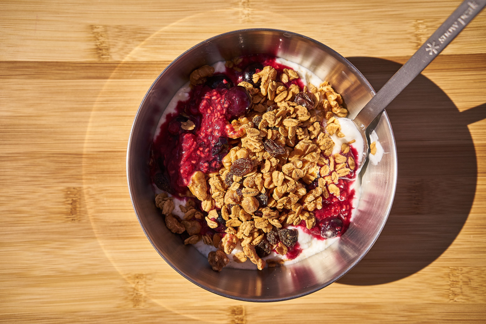 Yogurt with stewed berries and granola is a super easy car camping breakfast idea! Click through for the entire recipe and video tutorial. #campfood #camping #campbreakfast www.amandaoutside.com