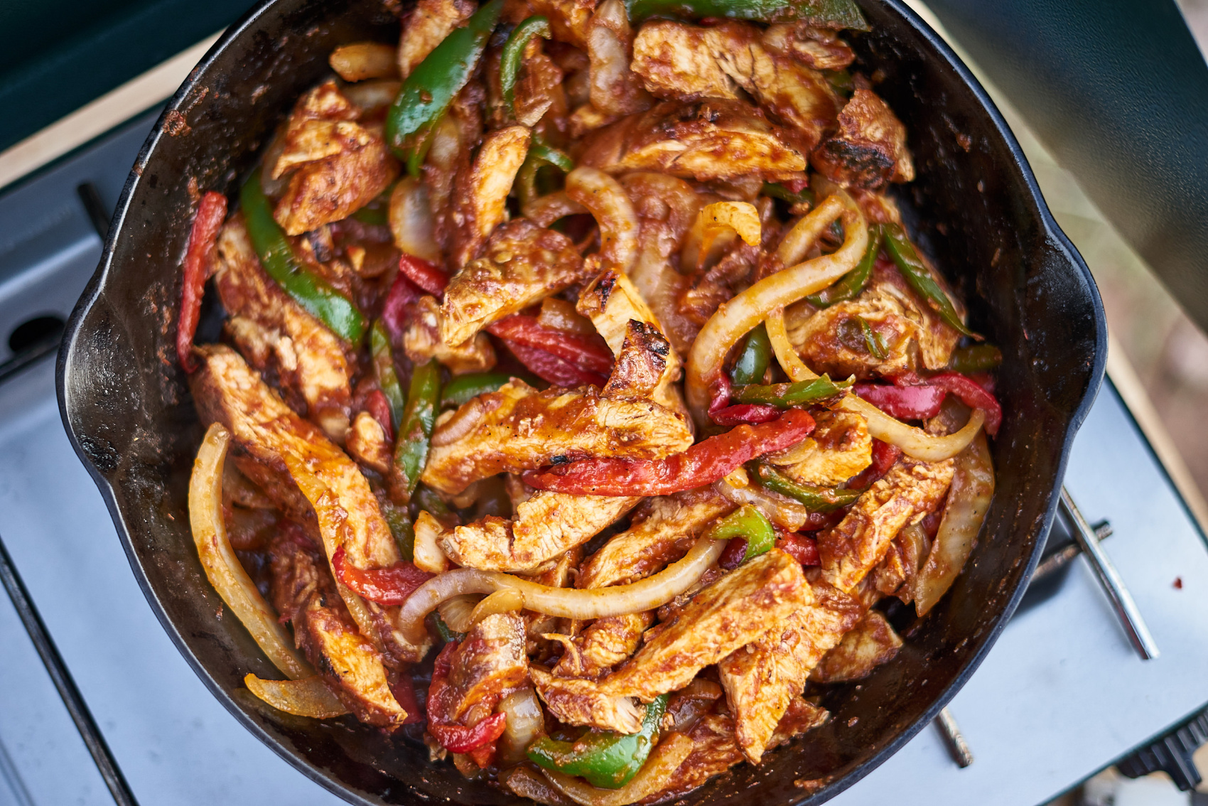 The ultimate car camping chicken fajitas. Click through to see how to make them while camping! (www.amandaoutside.com)