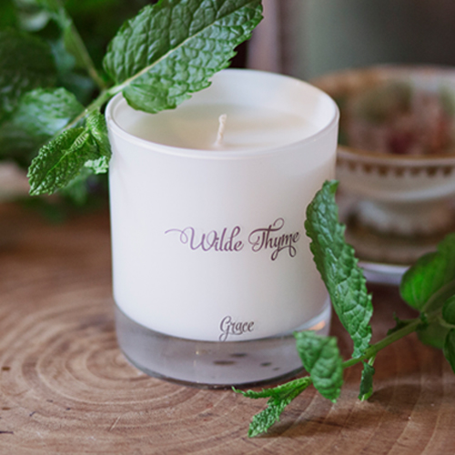 Grace   HERBAL : Grace is an intense infusion of Peppermint and spearmint with a splash of white tea. Your favourite Summer mojito cocktail that doesn't stop you from driving! Grace is our charity candle, supporting  J.A.A.R.