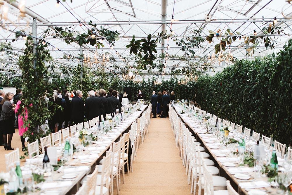 27-wilde-thyme-wedding-event-florist-flowers-green-house-wedding-ceiling-decor-hanging-foliage.jpg