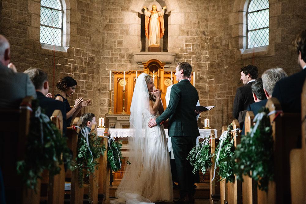 29-wilde-thyme-wedding-event-florist-flowers-winter-church-wedding-bride-groom-pew-ends.jpg