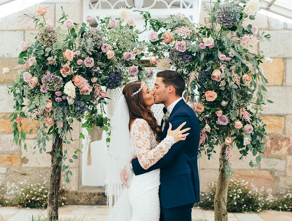 1-wilde-thyme-wedding-flowers-ceremony-arch-muted-blush-ivory-durrell-jersey.jpg