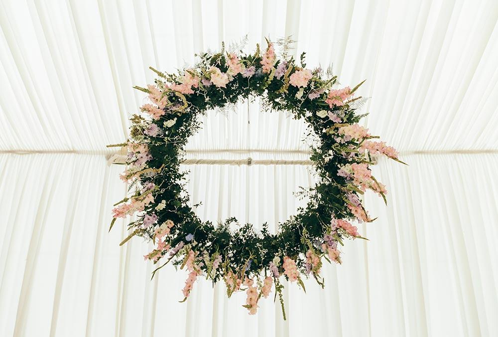 8-wilde-thyme-wedding-flowers-ceiling-installation-hanging-flowers-hoop-marquee-decor-blush-ivory.jpg