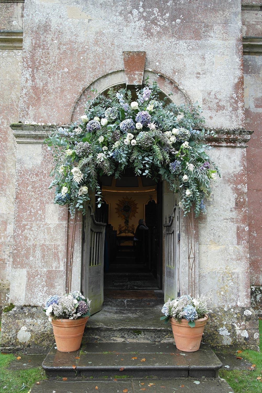 6-babington-house-chapel-arch-flowers-hydrangeas-roses-wilde-thyme-florist-jersey-wedding-events-styling.jpg