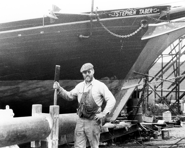 Captain Ken Barnes refitting the schooner, 1981