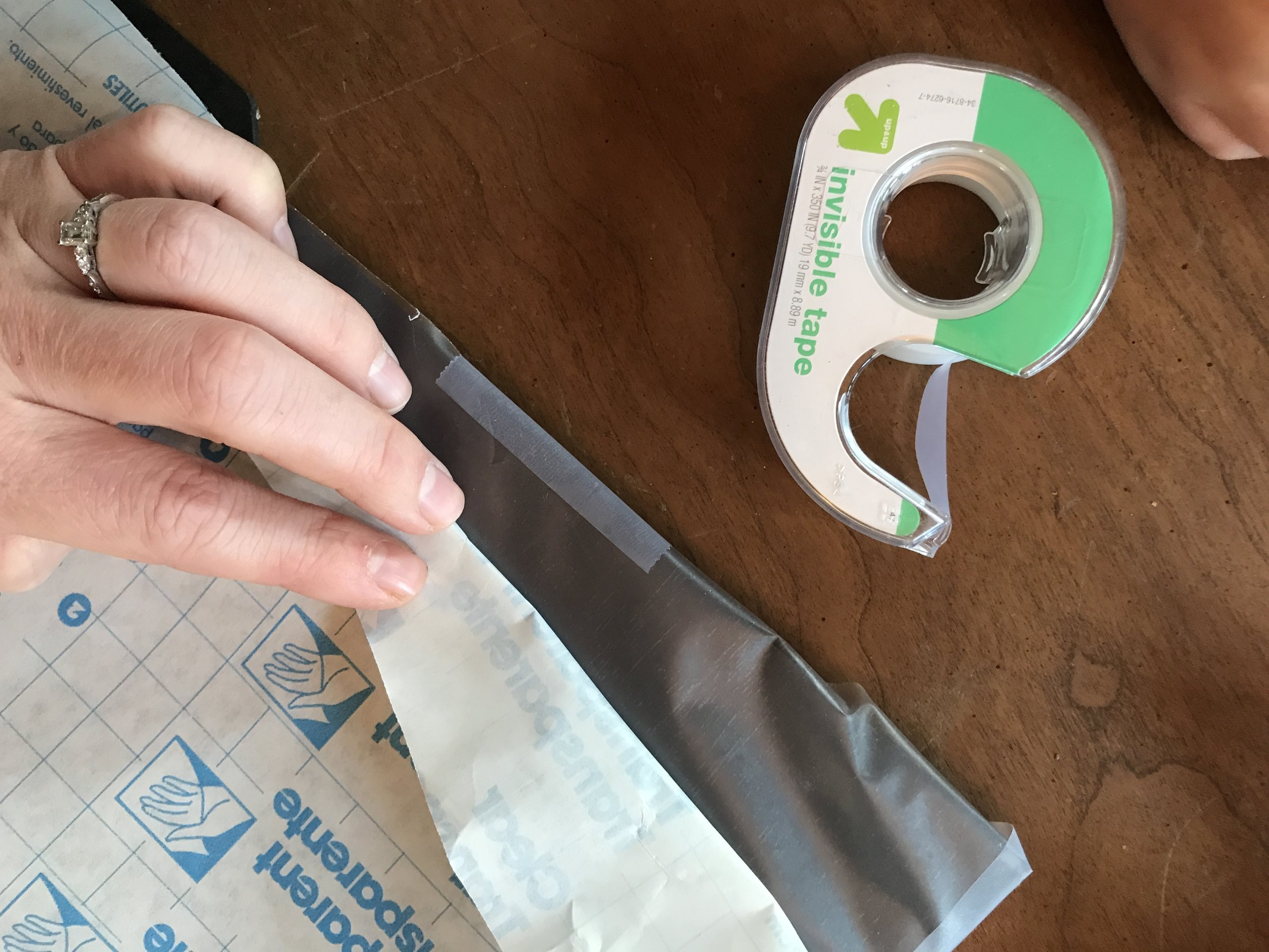 I find it easiest to peel and tape at the same time.