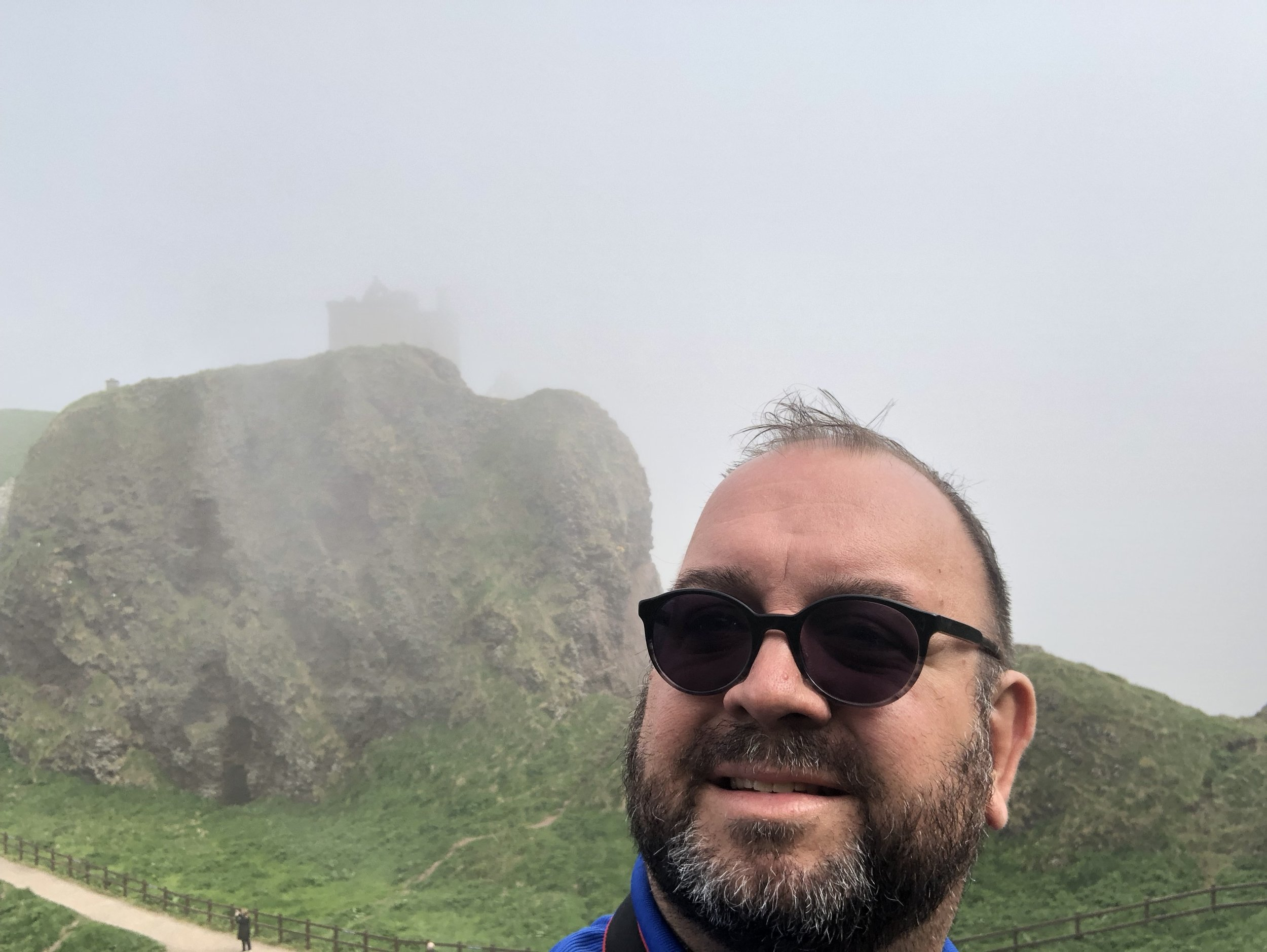 Roaming Rich in the mist at Dunnottar Castle.